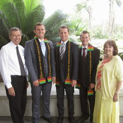 President Norman Hill, far left, and his wife, Raelene Hill, prepare to say goodbye to three missionaries in December 2014. The missionaries had completed their service in the Ghana Accra West Mission and had received their traditional mission Kente banners. The missionaries are, left to right, Elder Mitchell Hansen, Elder Thomas Fornaro and Elder Donovan Poland.