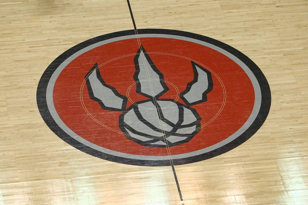 Many fan-favorites have graced this floor for the Toronto Raptors, however only one has actually gone so far as to plant a kiss on it.  Mandatory Credit: Tom Szczerbowski-US PRESSWIRE