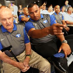 Former head coach LaVell Edwards and current head coach Kaliani Sitake watch a reunion segment being filmed on the 1996 Cotton Bowl champion football team  during BYU Media Day at BYU Broadcasting in Provo on Thursday, June 30, 2016.