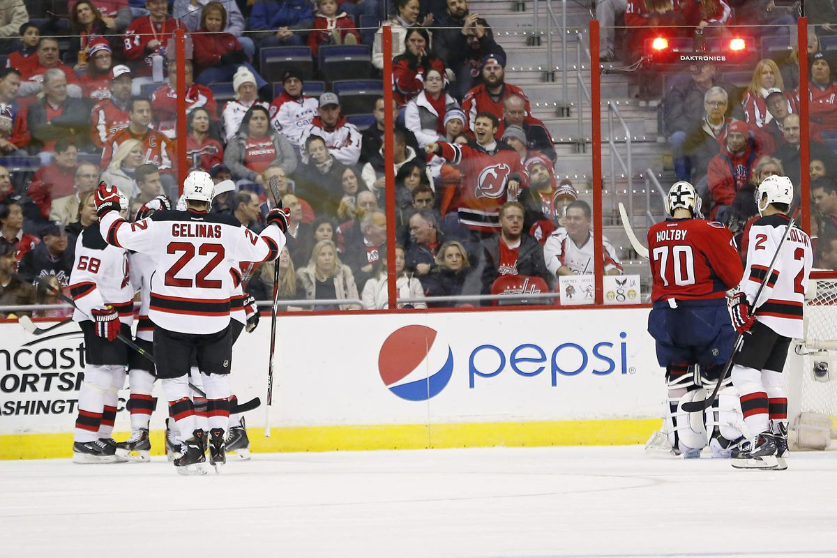 The aftermath of the game's only goal.  Shout out to the Devils fan doing the right thing in this picture.