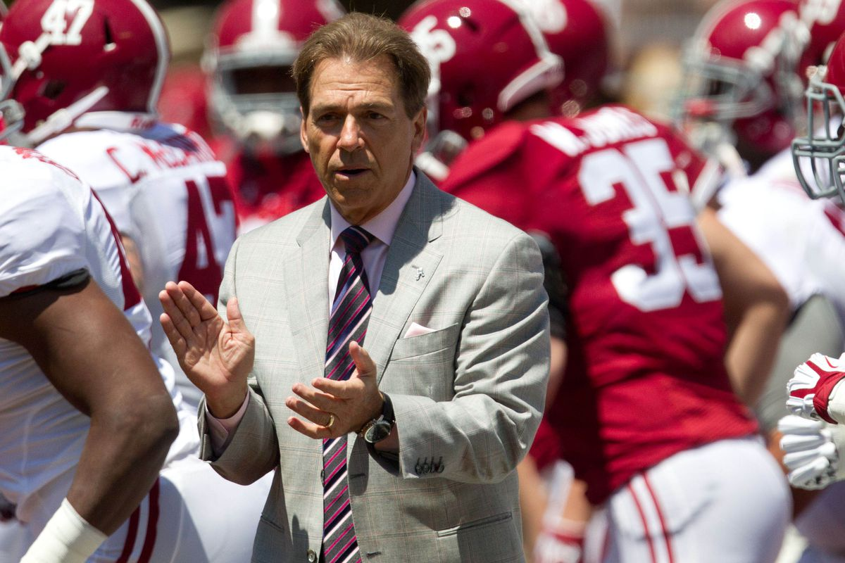 I just love that Saban wears a suit for the Alabama spring games.