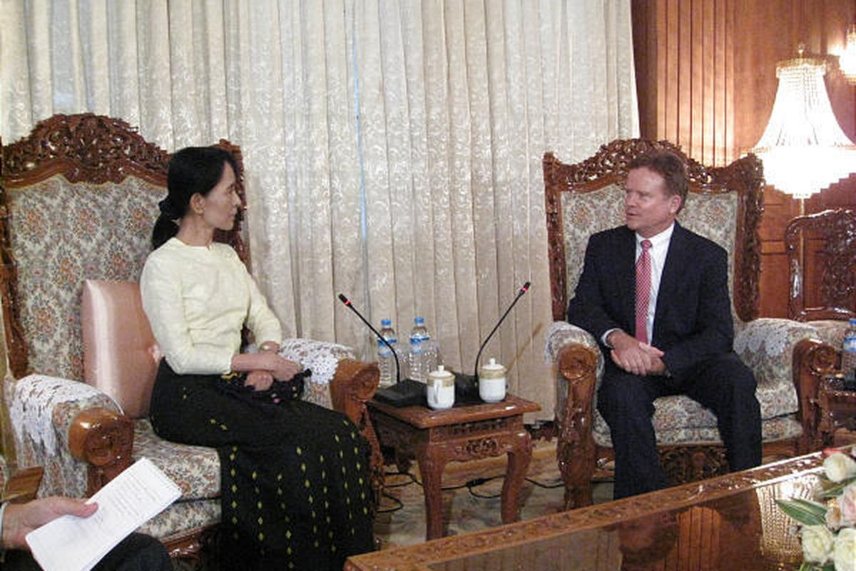 In this photo released by the office of U.S. Sen. Jim Webb, D-Va., Webb, right, meets with Myanmar's detained democracy leader Aung San Suu Kyi in Yangon, Myanmar, Saturday.