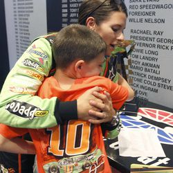 Driver Danica Patrick, right, hugs Lane Doyle, 8, after qualifying for the NASCAR Nationwide Series auto race at Texas Motor Speedway. Friday, April 13, 2012, in Fort Worth, Texas.