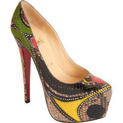 "Christian Louboutin Python Masai Daffodile Pump, $2,995 at <a href=""http://www.barneys.com/Christian-Louboutin-Python-Masai-Daffodile/502270703,default,pd.html?cgid=womens-shoes&index=5"">Barneys</a>."