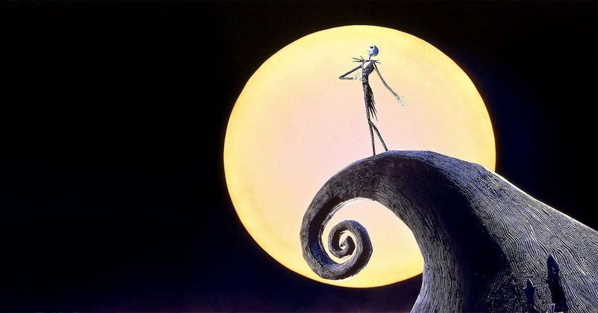 jack skellington atop a mountain with a large moon