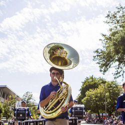 Eric Loresen marches along with the Stansbury High School marching band during the Days of '47 Union Pacific Railroad Youth Parade held Saturday, July 18, 2015, in Salt Lake City.