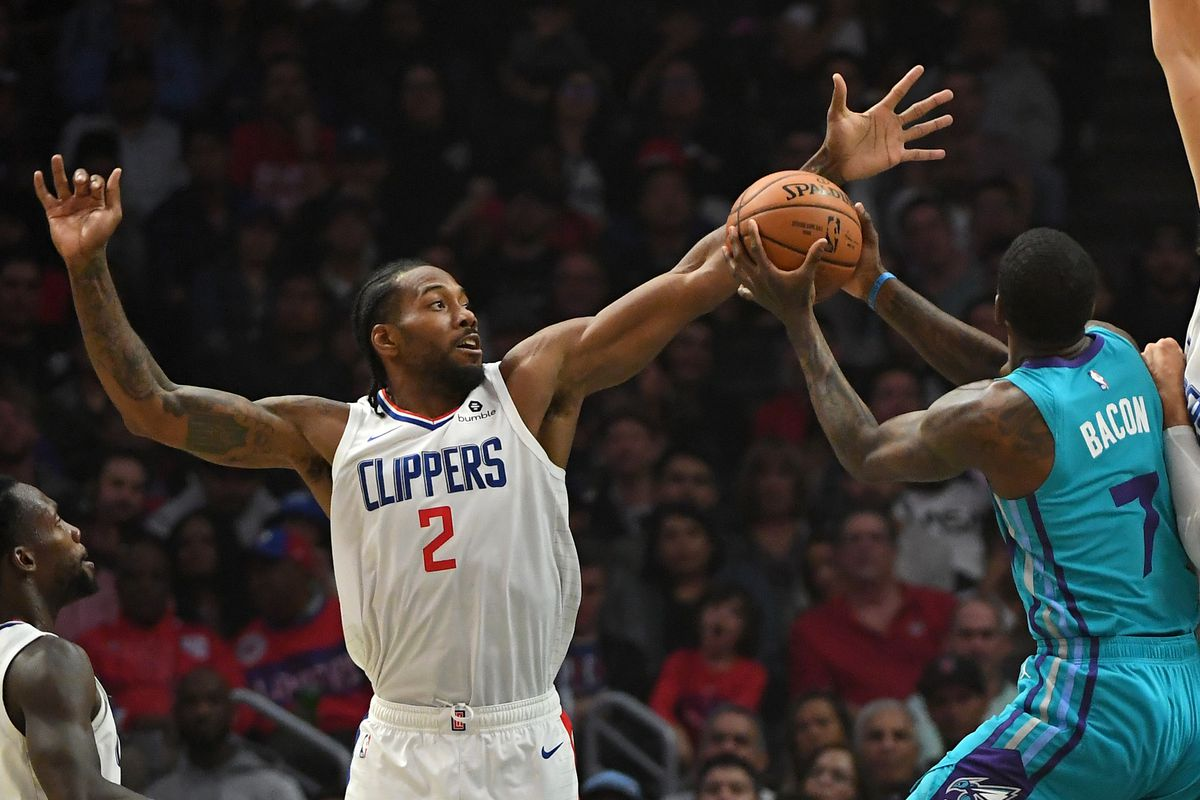 Los Angeles Clippers forward Kawhi Leonard blocks a shot by Charlotte Hornets guard Dwayne Bacon in the first half of the game at Staples Center.