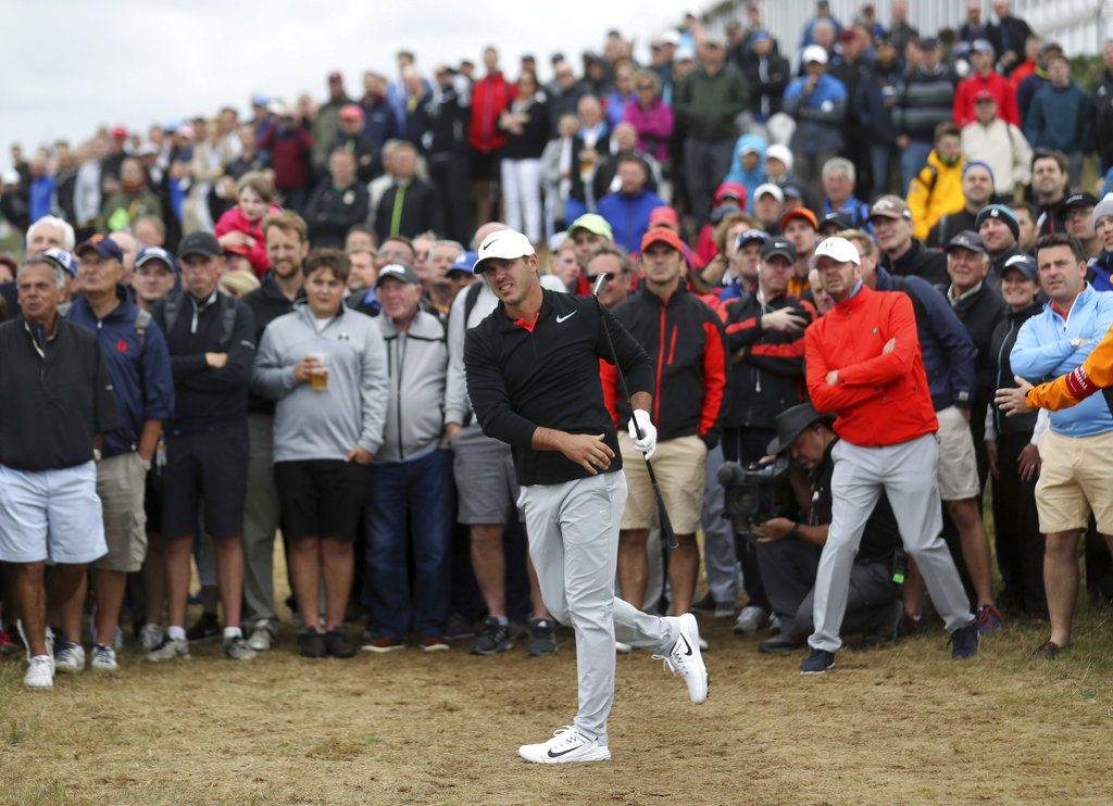 Brooks Koepka of the United States plays out of the rough on the 15th hole during the first round of the British Open Golf Championship. | Peter Morrison/Associated Press