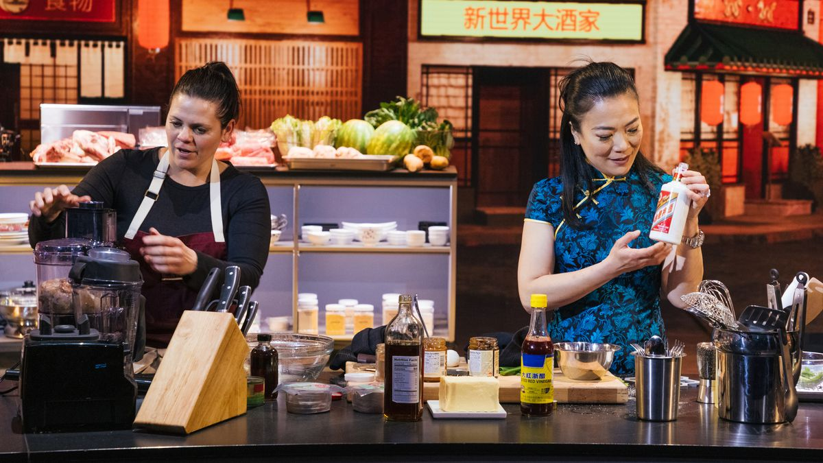 Two women look at ingredients for a cooking show