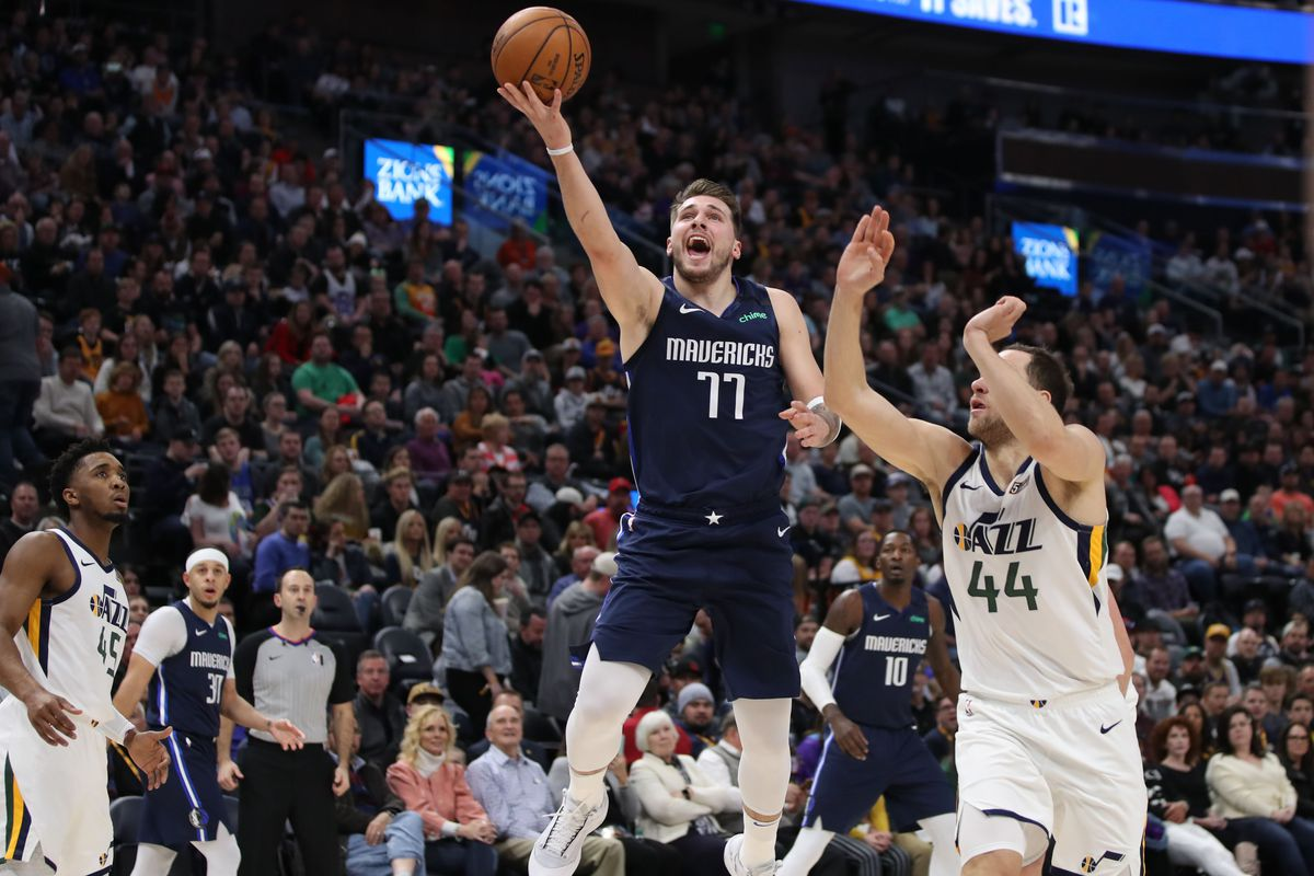 Dallas Mavericks guard Luka Doncic lays the ball up to the basket after getting past Utah Jazz guard Joe Ingles during the first quarter at Vivint Smart Home Arena.