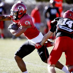 Utah Utes running back T.J. Green runs past Ben Renfro (14) during practice at the Spence and Cleone Eccles Football Center in Salt Lake City on Thursday, March 5, 2020.