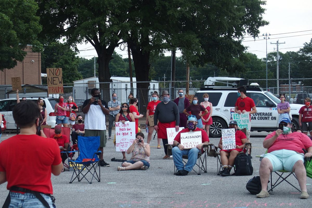 About 80 people gathered at Shelby County Schools' central office on Tuesday afternoon to protest in-person instruction.