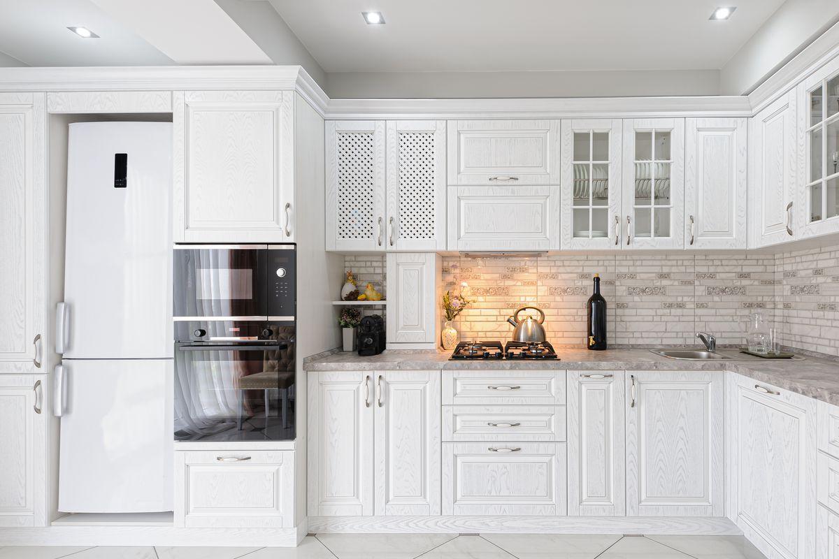 Modern white wooden kitchen cabinets.