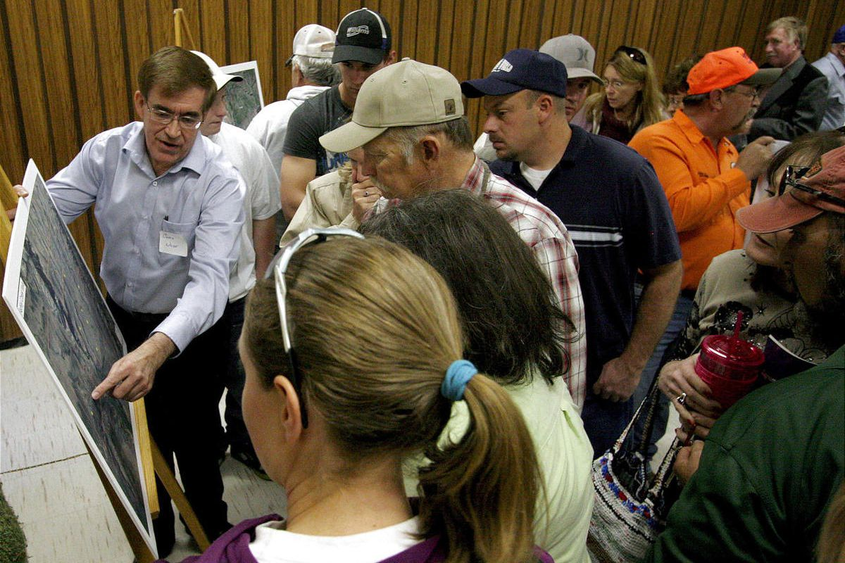 Chris Wilde, director of business development for Utah Phosphate Co., left, talks with Uintah County residents Tuesday about the company's plans to mine near Ashley Spring.