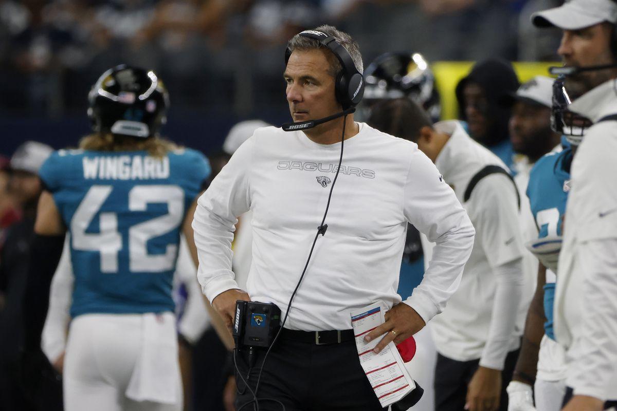 Jacksonville Jaguars head coach Urban Meyer, center, watches play against the Dallas Cowboys.