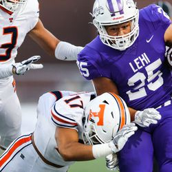 Lehi's Takeshi Faupula (25) carries the ball against the Timpview defense during a high school football game at Lehi High School in Lehi on Friday, Sept. 25, 2020.
