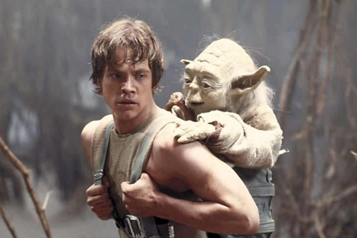"""Mark Hamill as Luke Skywalker and the character Yoda appear in this scene from """"Star Wars Episode V: The Empire Strikes Back."""""""