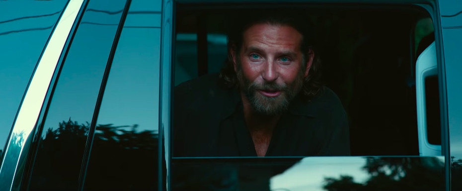 A bearded Bradley Cooper in 'A Star Is Born' staring out of a car window