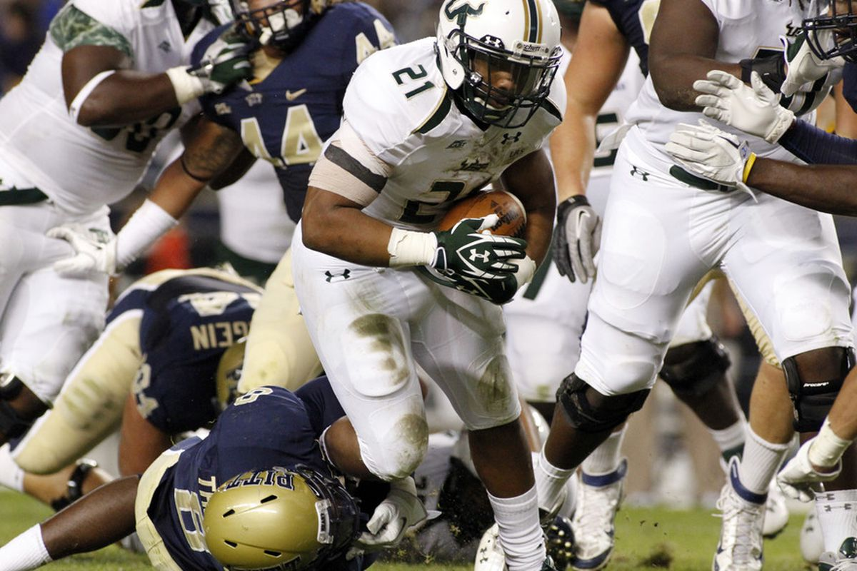 PITTSBURGH, PA - SEPTEMBER 29:  Demetris Murray #21 of the South Florida Bulls carries the ball against the Pittsburgh Panthers during the game on September 29, 2011 at Heinz Field in Pittsburgh, Pennsylvania.  (Photo by Justin K. Aller/Getty Images)