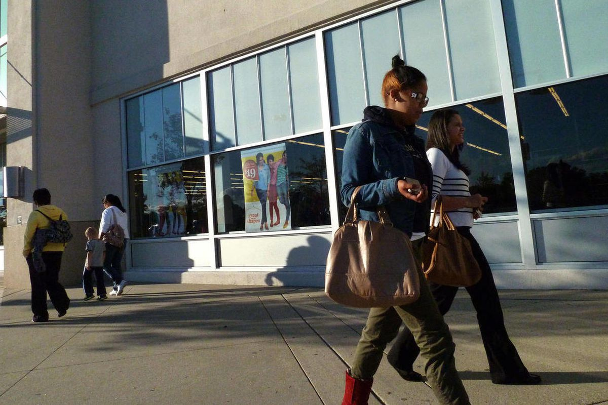 In this Monday, Sept. 24, 2012, photo, shoppers walk by stores at the Loop in Methuen, Mass. U.S. consumer confidence jumped this month to the highest level since February, bolstered by a brighter hiring outlook. The Conference Board said Tuesday, Sept. 2