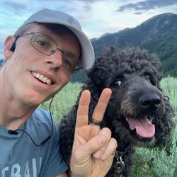 Jason Steed and Pepper, his 5-year-old labradoodle, near Sardine Peak.
