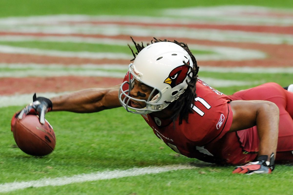 GLENDALE, AZ:  Larry Fitzgerald #11 of the Arizona Cardinals dives into the endzone against the San Francisco 49ers at University of Phoenix Stadium in Glendale, Arizona. Arizona won 21-19.  (Photo by Norm Hall/Getty Images)