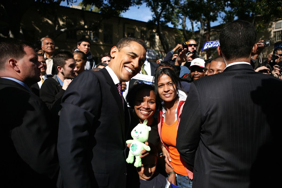 Obama's holding a Care Bear because why not