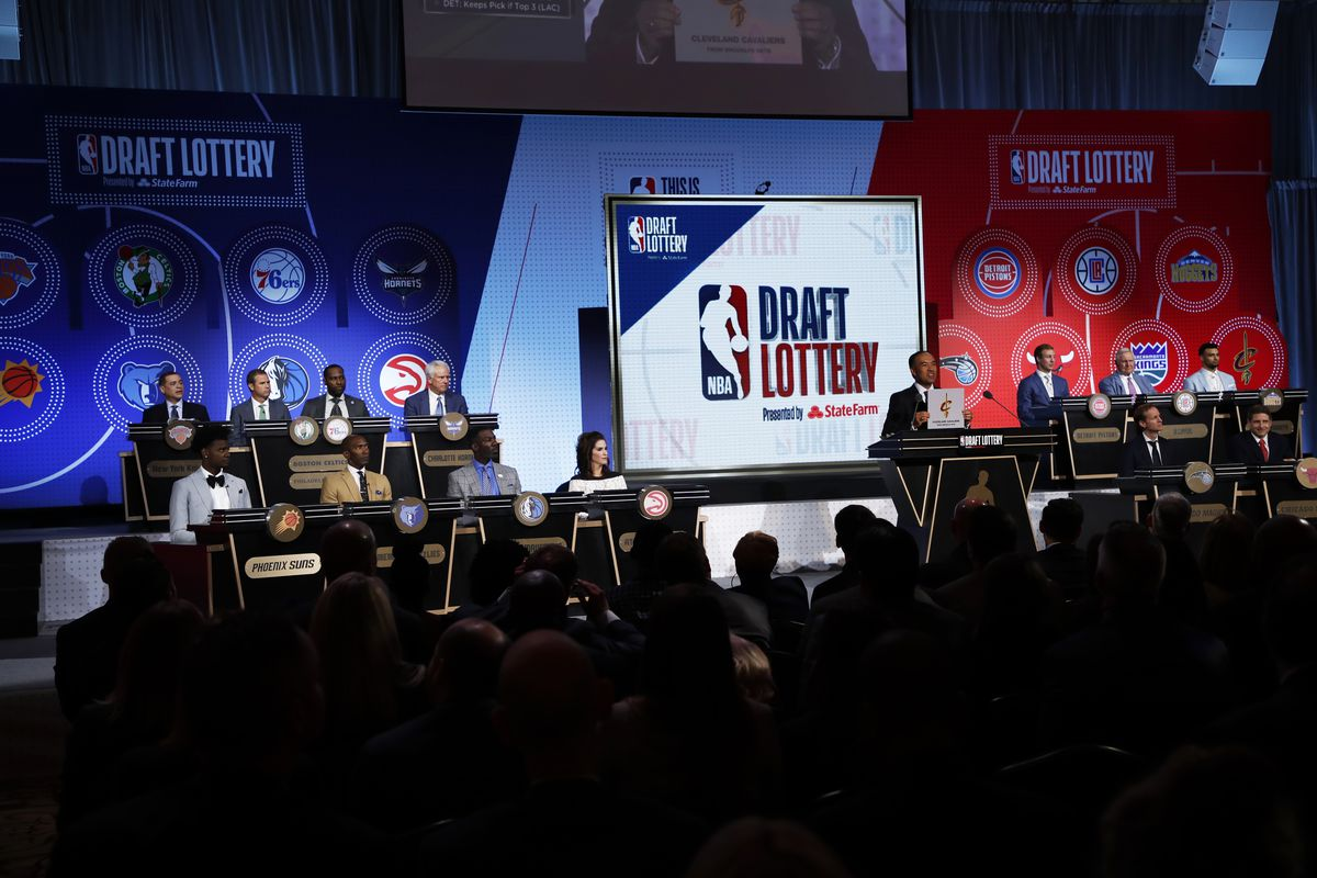 NBA Deputy Commissioner, Mark Tatum awards the Cleveland Cavaliers the number eight pick in the 2018 NBA Draft during the 2018 NBA Draft Lottery at the Palmer House Hotel on May 15, 2018 in Chicago Illinois.
