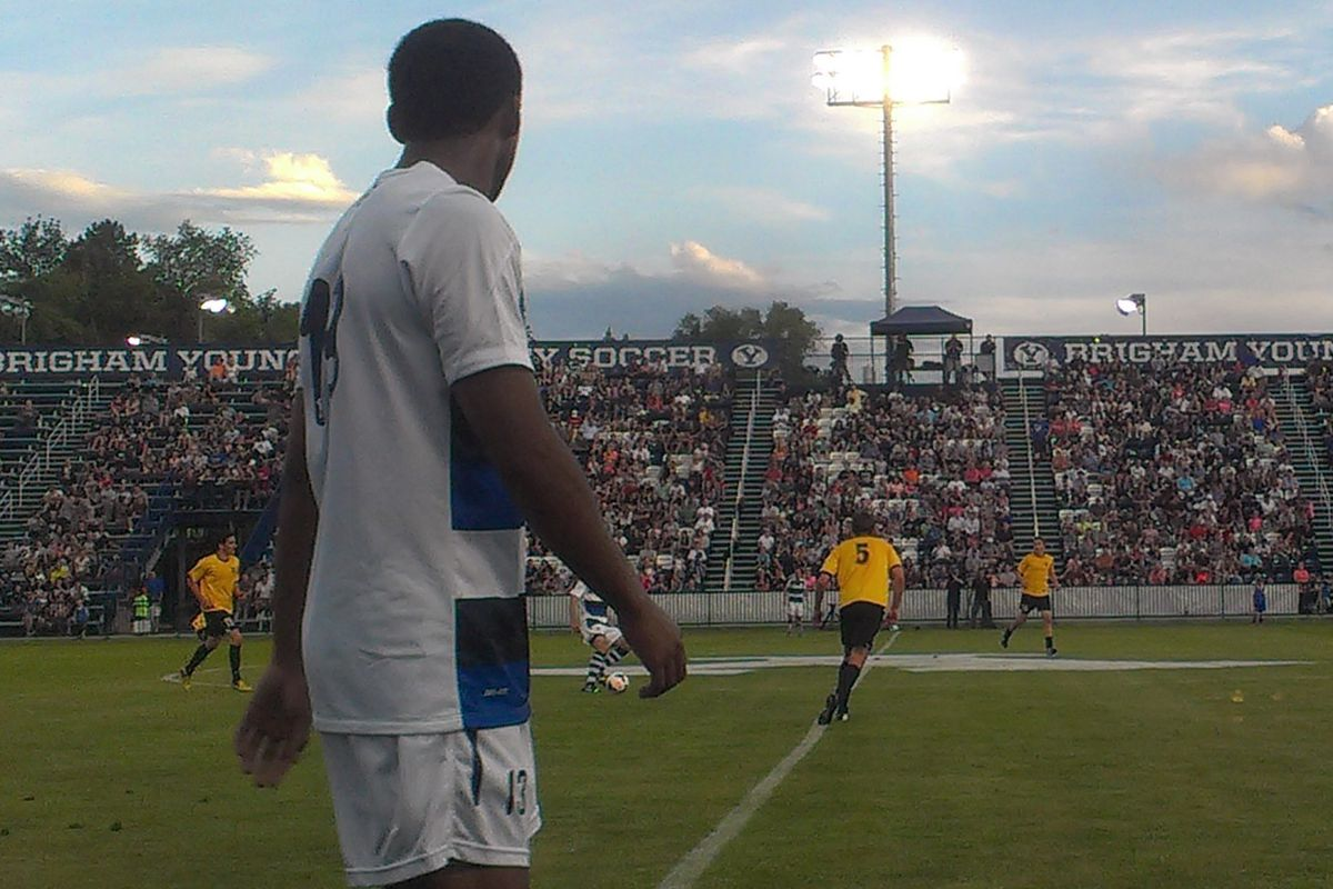 Junior Lartey watches play on the opposite side of the field.