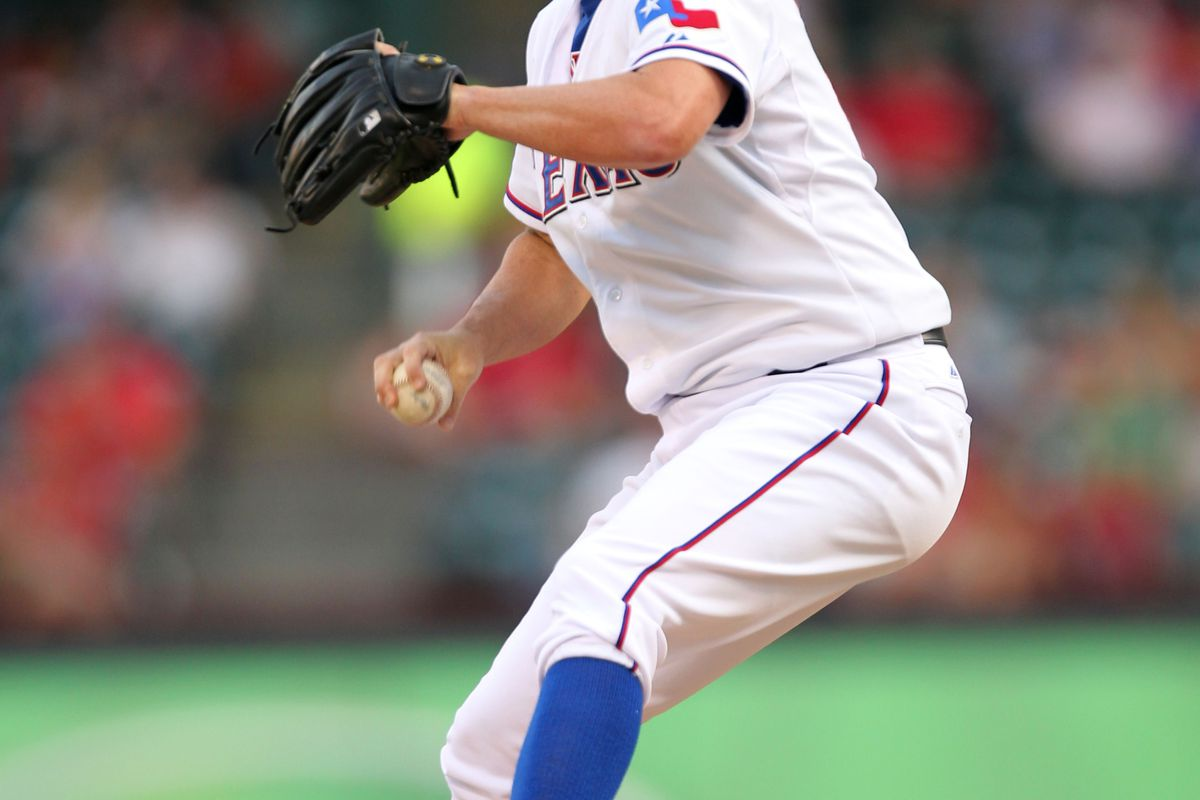 ARLINGTON, TX - AUGUST 23: Roy Oswalt #44 of the Texas Rangers pitches against the Minnesota Twins on August 23, 2012 at the Rangers Ballpark in Arlington in Arlington, Texas. (Photo by Layne Murdoch/Getty Images)