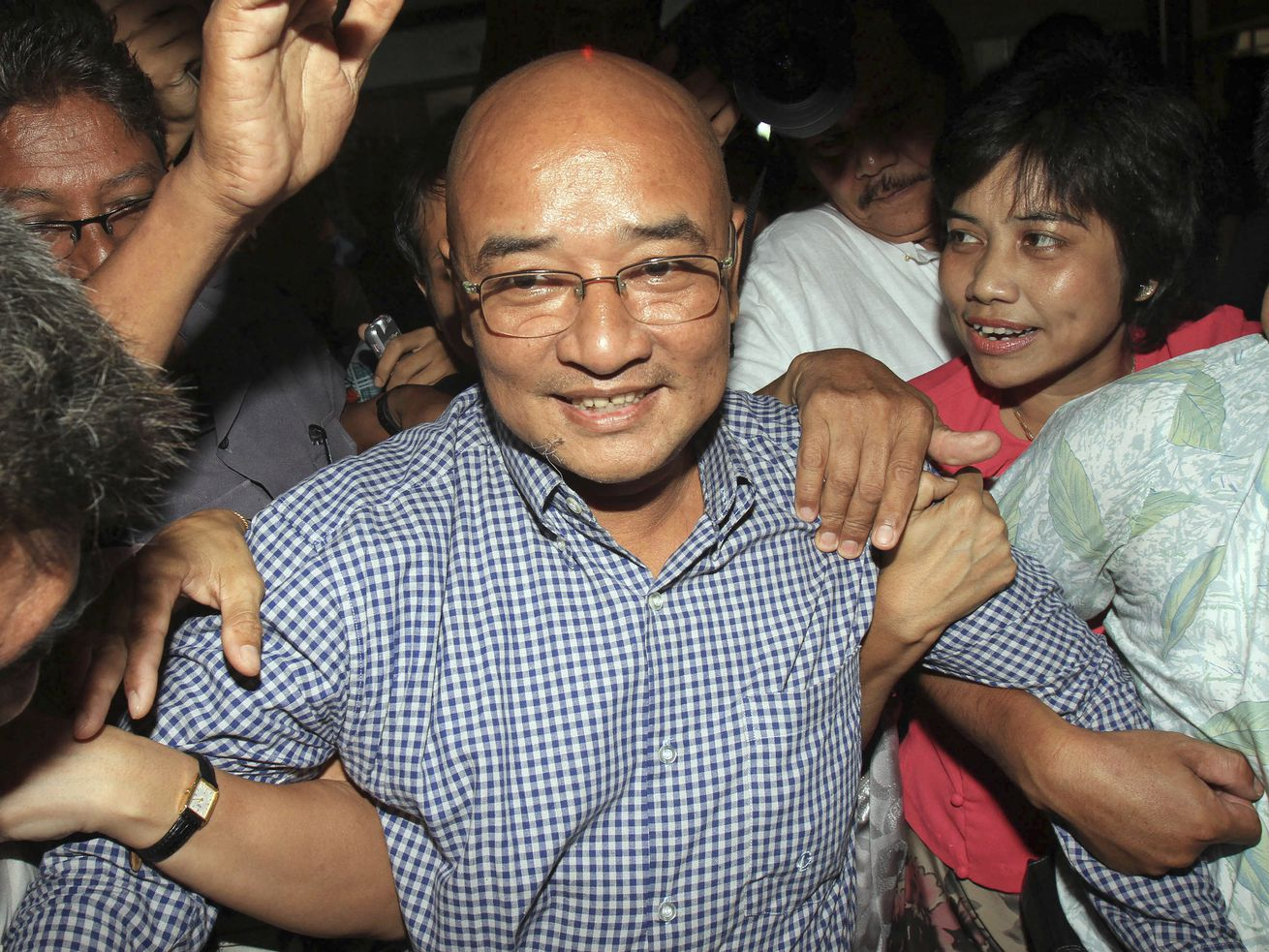 n this Oct. 12, 2011, file photo, Myanmar's comedian and activist Zarganar, who was serving a 35-year sentence in Myitkyina prison in northernmost Kachin State, arrives at Yangon International Airport in Yangon, Myanmar, after he was released early on Wednesday, Oct. 12, 2011.