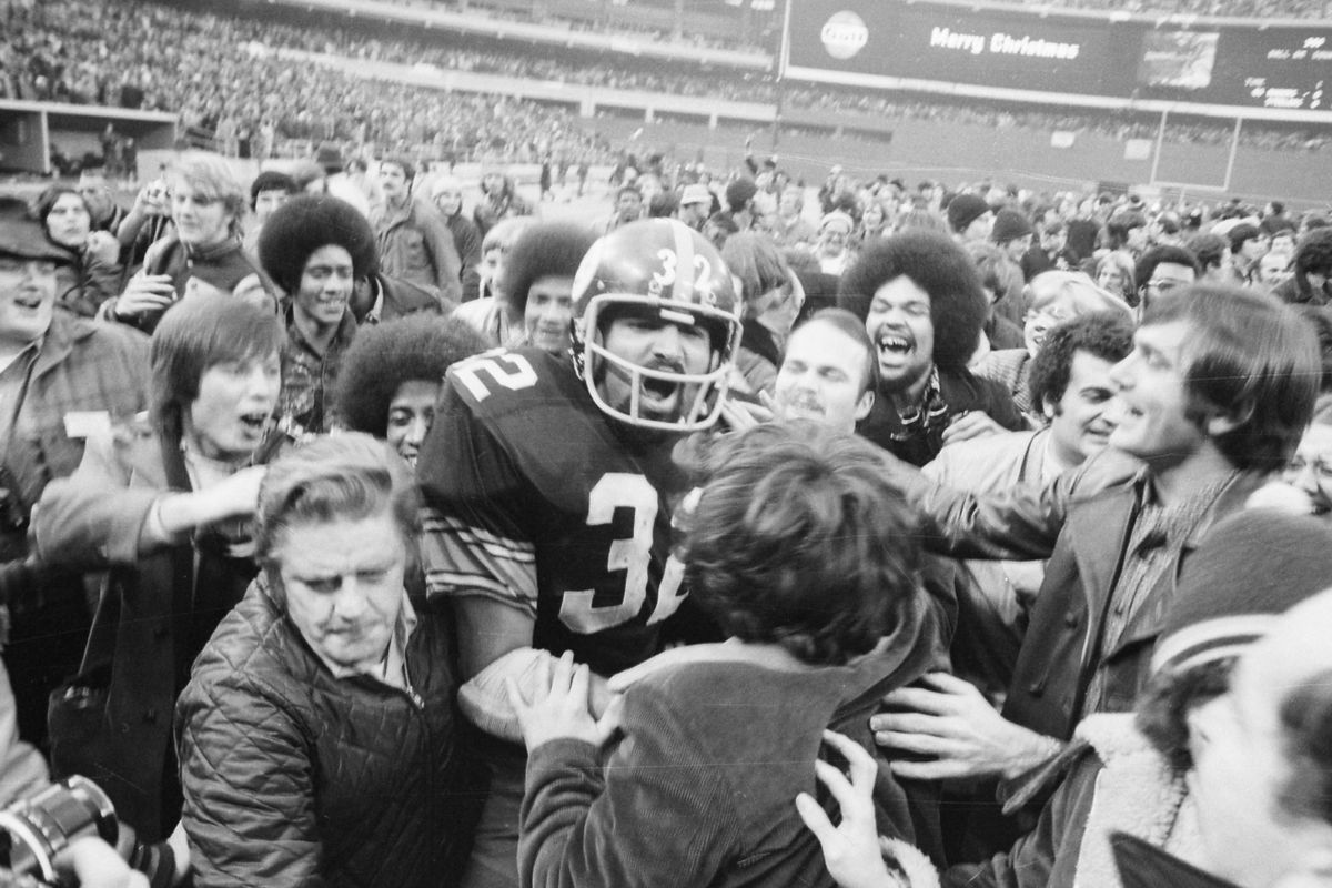 Fans Mob Franco Harris of the Pittsburgh Steelers