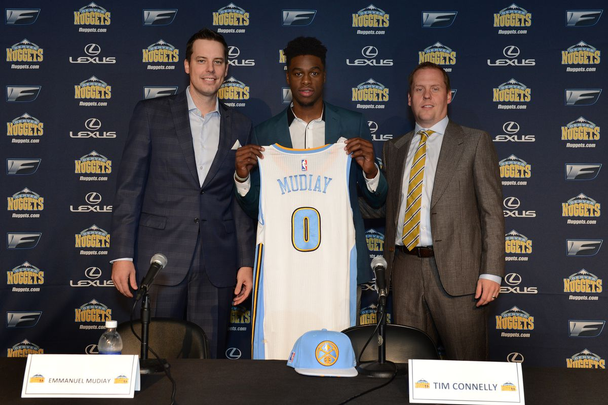 Josh Kroenke and Tim Connelly welcome Emmanuel Mudiay to Denver.