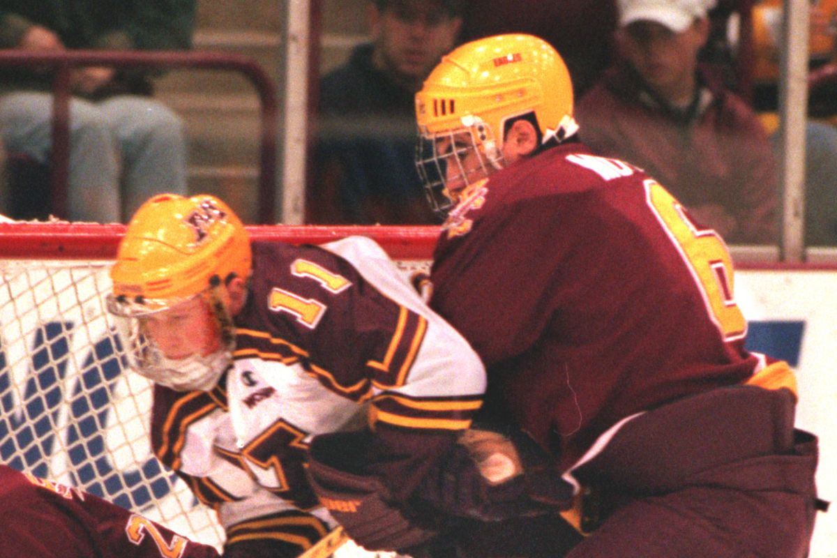 The Gopher's Dave Spehar gets the squeeze put on him by Boston College's goalie Greg Taylor and Mike Mottau as Spehar attempts to ge to the puck ist period action at Marriuci.(Photo by MARLIN LEVISON/Star Tribune via Getty Images)
