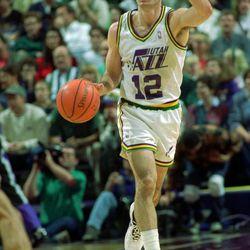 John Stockton brings the ball upcourt during a Utah Jazz game.