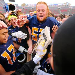 Orem players celebrate after defeating Mountain Crest 26-0 for the 4A football championship at Rice Eccles Stadium at The University of Utah in Salt Lake City on Friday, Nov. 17, 2017.