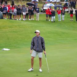 Spanish Fork's Jackson Rhees reacts after sinking his final putt, placing first in individual competition at the 5A boys state golf tournament at The Oaks at Spanish Fork in Spanish Fork on Tuesday, Oct. 5, 2021.