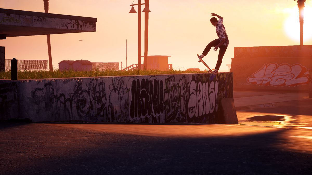 A skater does a lip trick against a sunset or sunrise