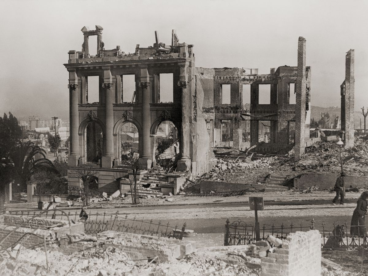 Black and white image of a building torn apart after a quake.