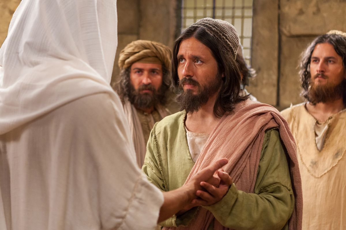 Jesus Christ approaches Thomas after Thomas declares that he will not believe unless he sees him in this image from the Bible Videos series.