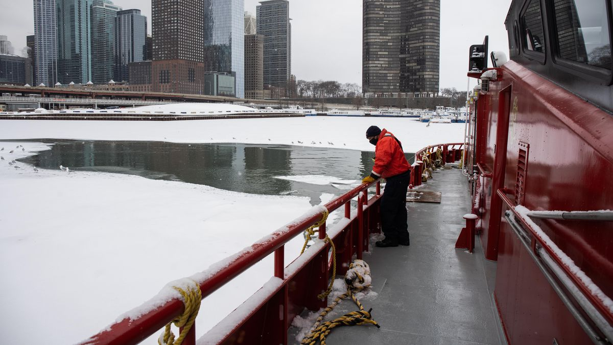"""Lt. John Cooper stands on the Chicago Fire Department's vessel, """"Christopher Wheatley,"""" which breaks ice that forms on the Chicago River, Thursday afternoon."""