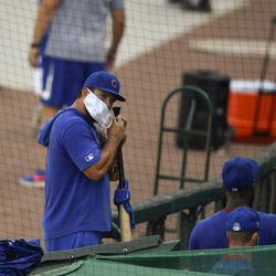 The now-departed Kyle Schwarber puts on a mask at Summer Camp, July 3