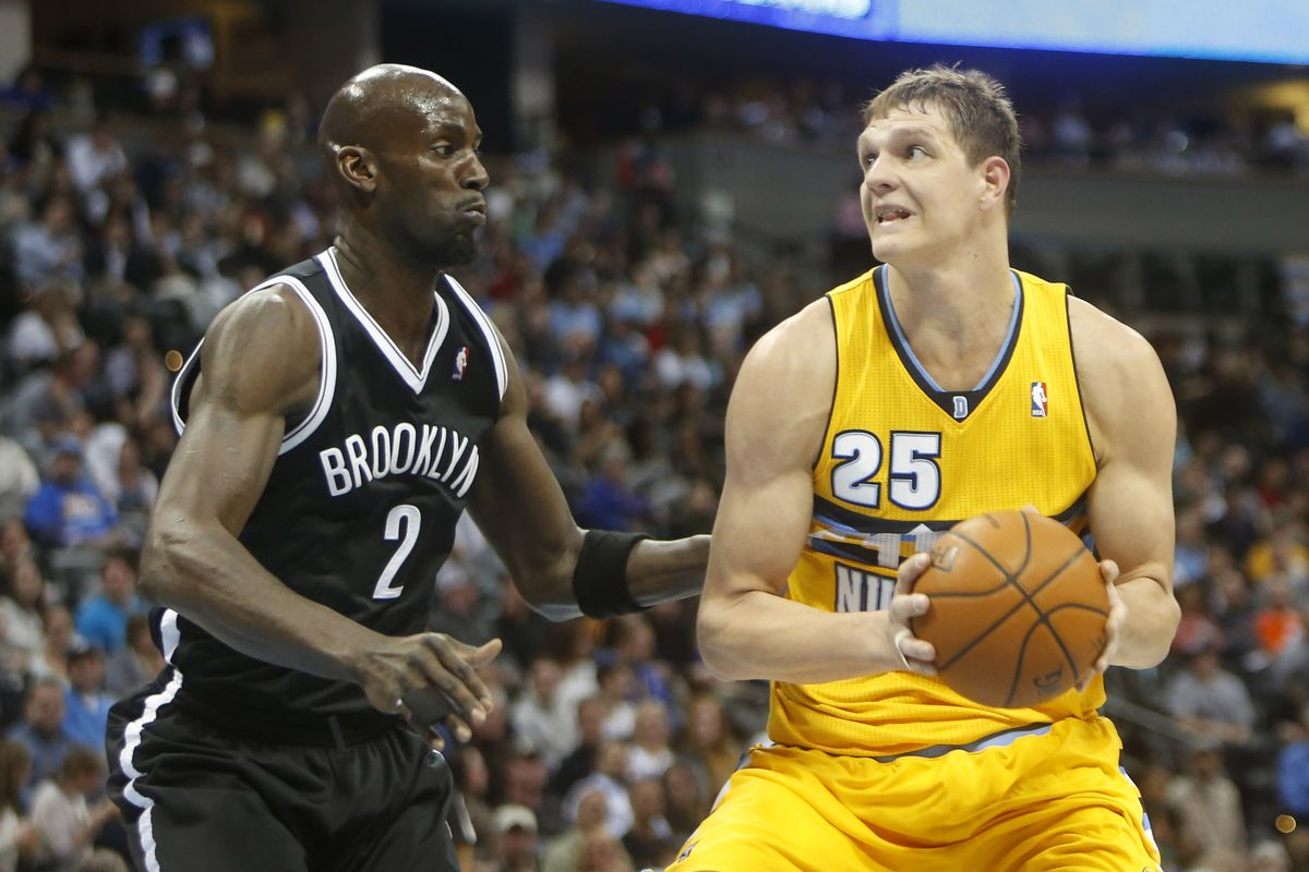 Timofey Mozgov (R) and the rest of the Denver Nuggets frontcourt have the advantage against the Brooklyn Nets.