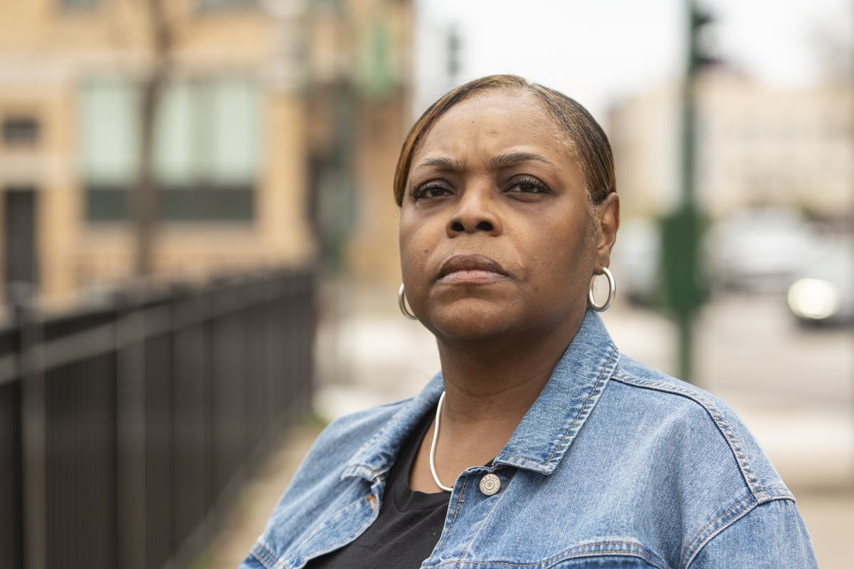 Faye Jenkins, a CPS cafeteria worker at Franklin, stands outside her apartment building in April.