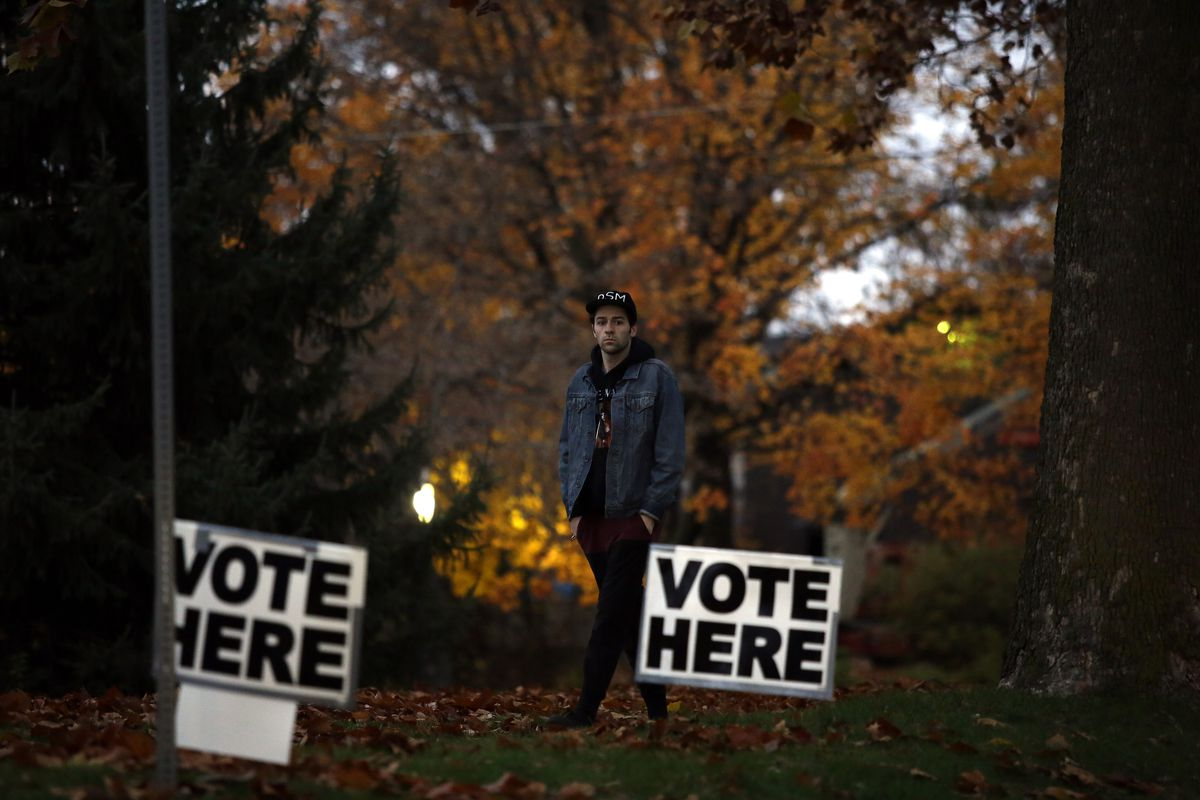 A man walks to the polls in Des Moines, Iowa on November 6, 2018.