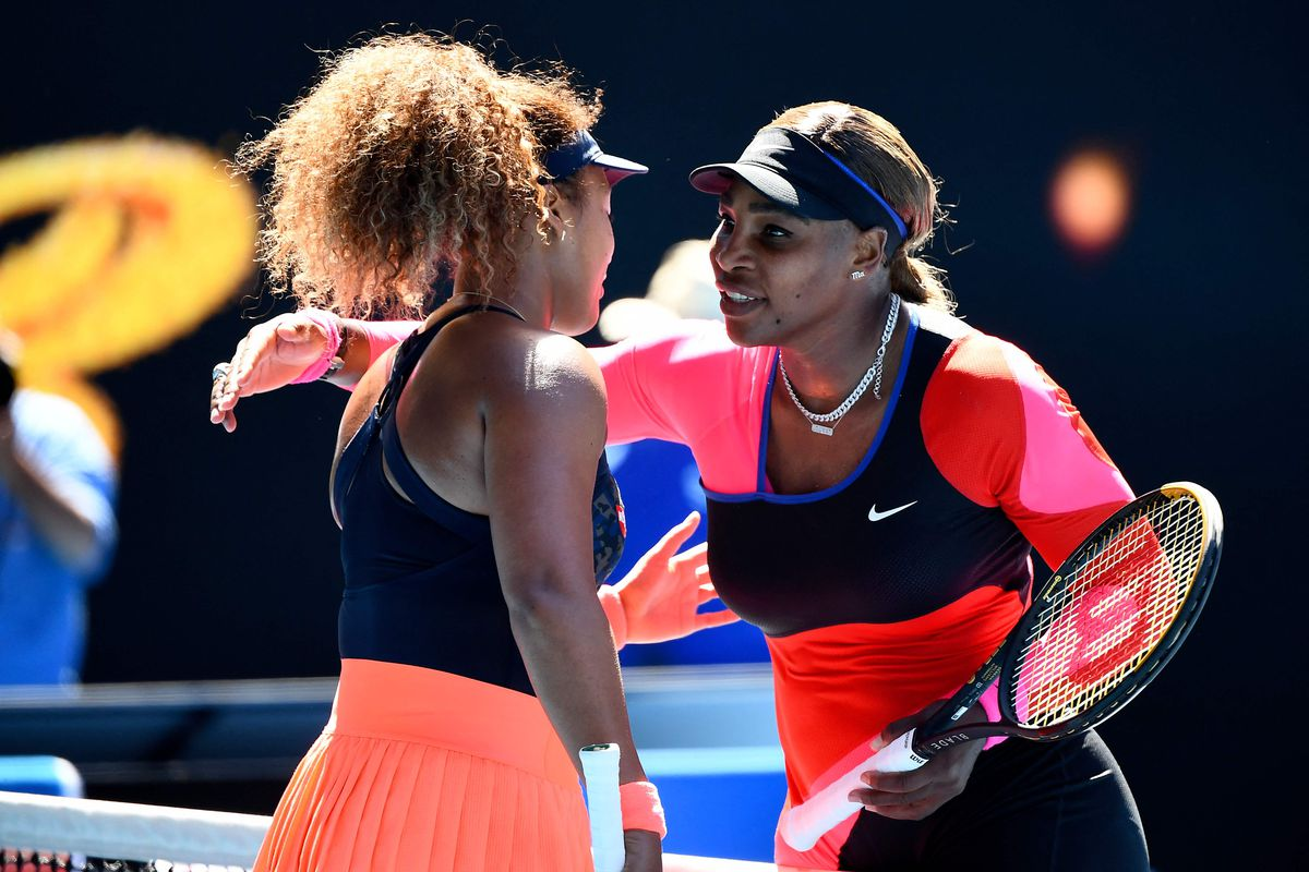 Naomi Osaka hugs Serena Williams after their women's singles semifinal match at the Australian Open.