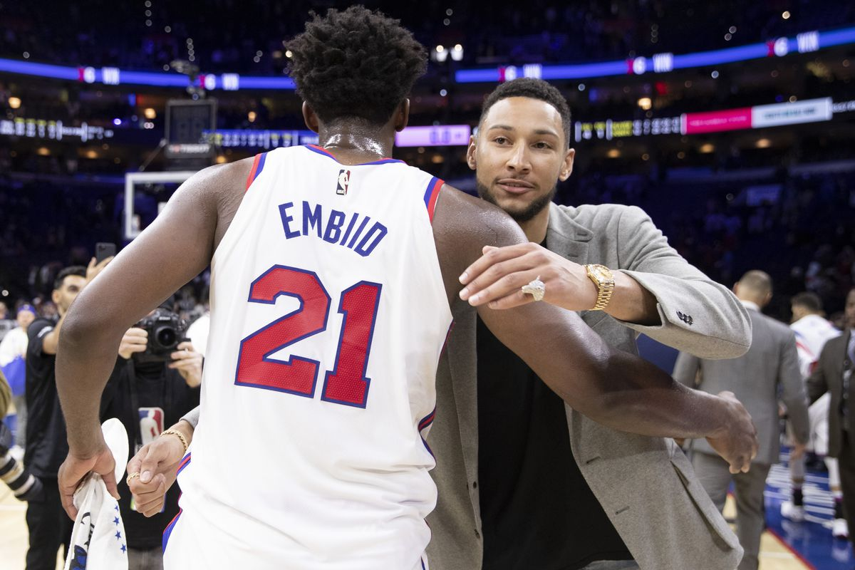 Joel Embiid of the Philadelphia 76ers hugs Ben Simmons after the game against the Brooklyn Nets at the Wells Fargo Center on February 20, 2020 in Philadelphia, Pennsylvania.