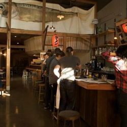 The open bar area up front, intended to vaguely replicate the feeling of waiting outside a ramen shop in Japan.