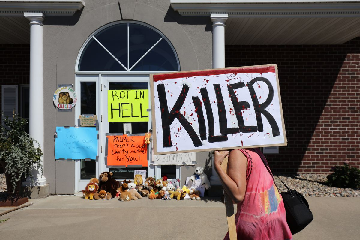 Protesters outside the office of Minnesota dentist Walter Palmer.