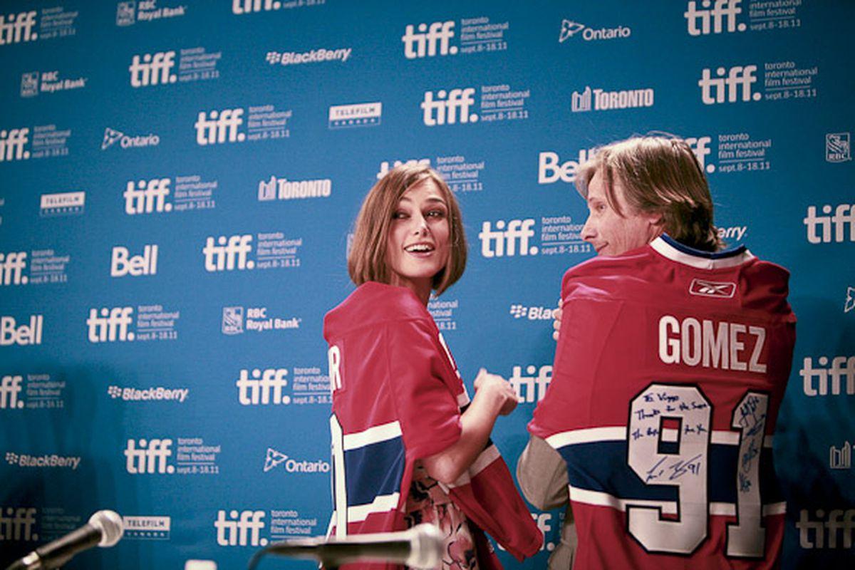 Keira Knightly and Viggo Mortensen take the podium, draped in Habs jerseys, at the Toronto International Film Festival. (Photo: BlogTO.com)